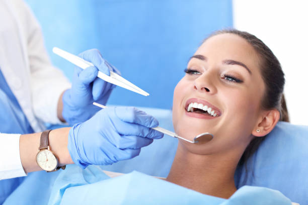 adult woman having a visit at the dentist's - dental care stock pictures, royalty-free photos & images