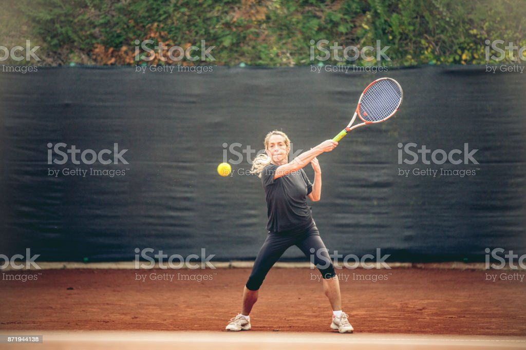 Adult Woman Hitting the Ball stock photo
