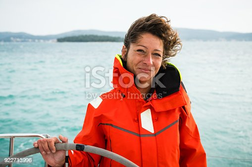 Adult Woman Holding the Rudder on Sailing Boat