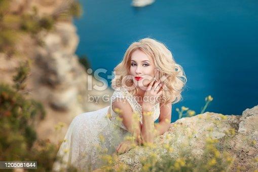 1054970060 istock photo Adult woman in wedding dress 1205081644
