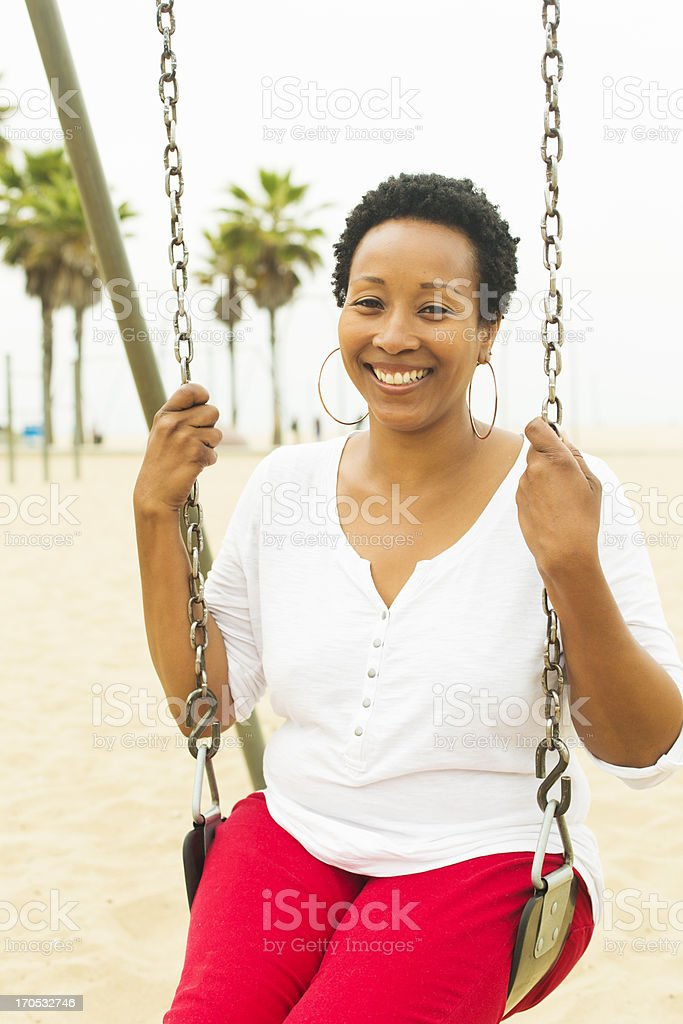 Adult Woman on a Swing royalty-free stock photo