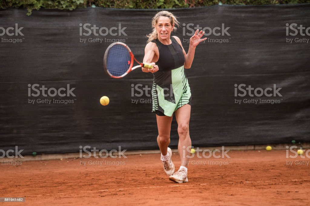 Adult Woman Playing Tennis stock photo
