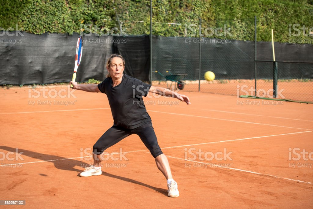 Adult Woman Preparing to Hit the Ball stock photo