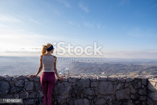 Adult woman hiking: border mountain of Italy and Slovenia. Europe.