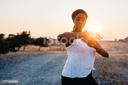 istock Adult Woman Running In Large Open Field at Sunset 1271840539