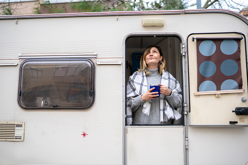 Adult woman thinks about her life and future in her caravan