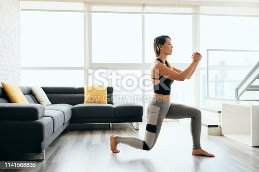 istock Adult Woman Training Legs Doing Inverted Lunges Exercise 1141568835