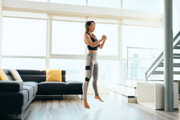 Adult Woman Training Legs Doing Squat and Jumping stock photo