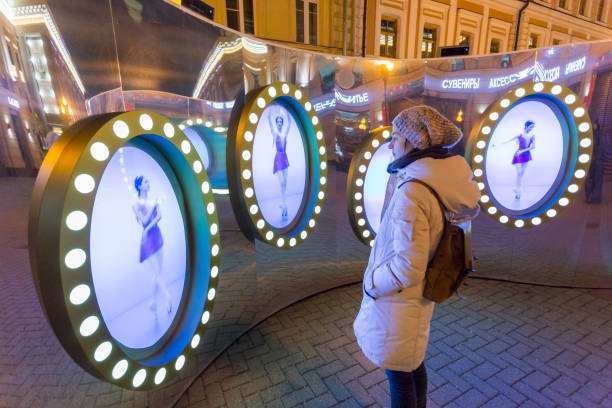 Adult woman watch at Christmas installation on Old Arbat in Moscow stock photo