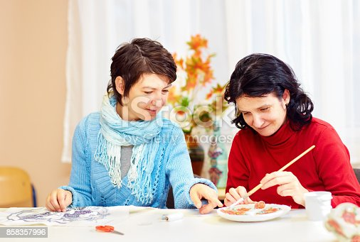 istock adult woman with special needs are engaged in handcraft in rehabilitation center 858357996