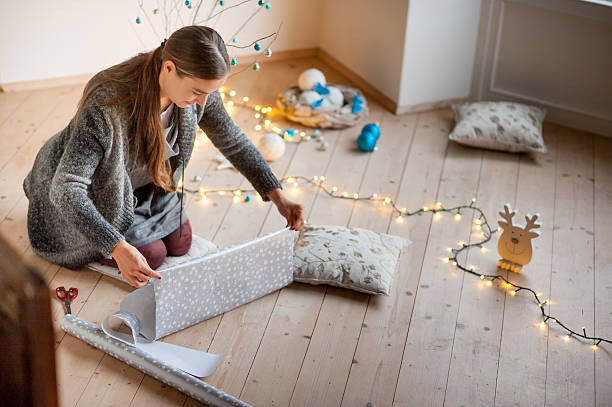 Adult Woman Wrapping Christmas Gifts stock photo