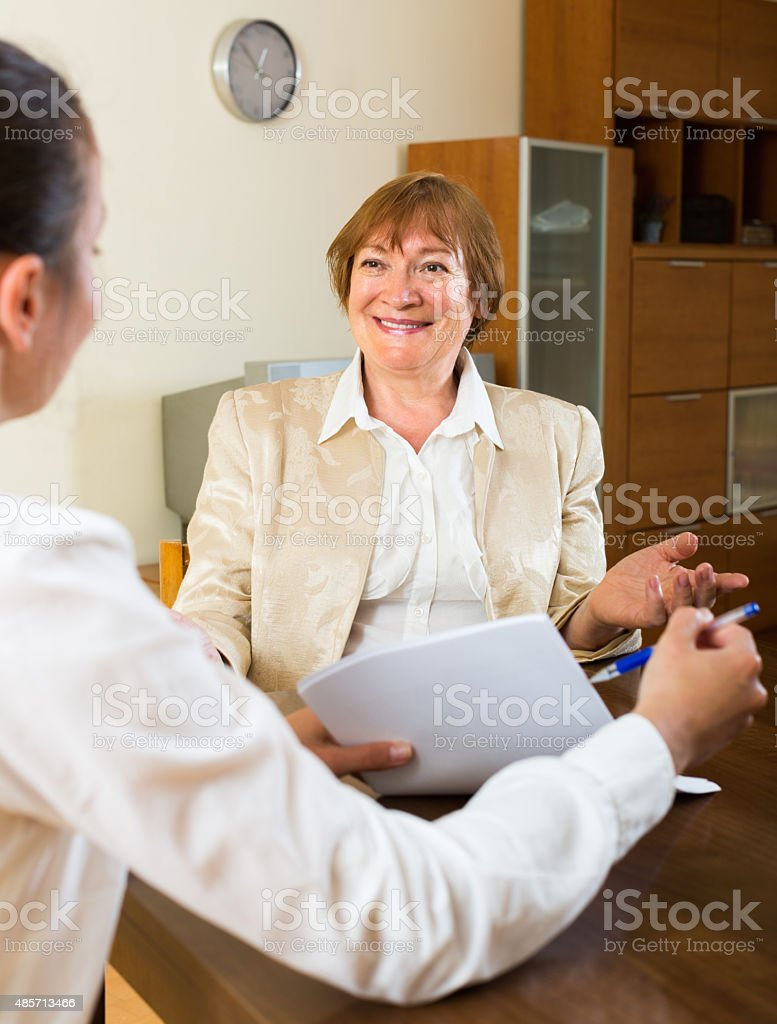 Adult women talking at the table stock photo
