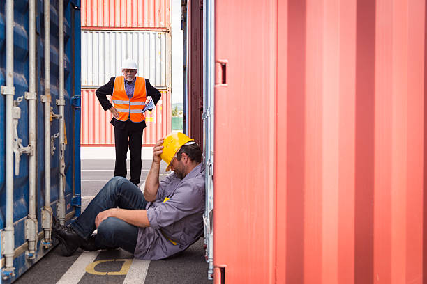 adult worker in large container port, sleeping stock photo