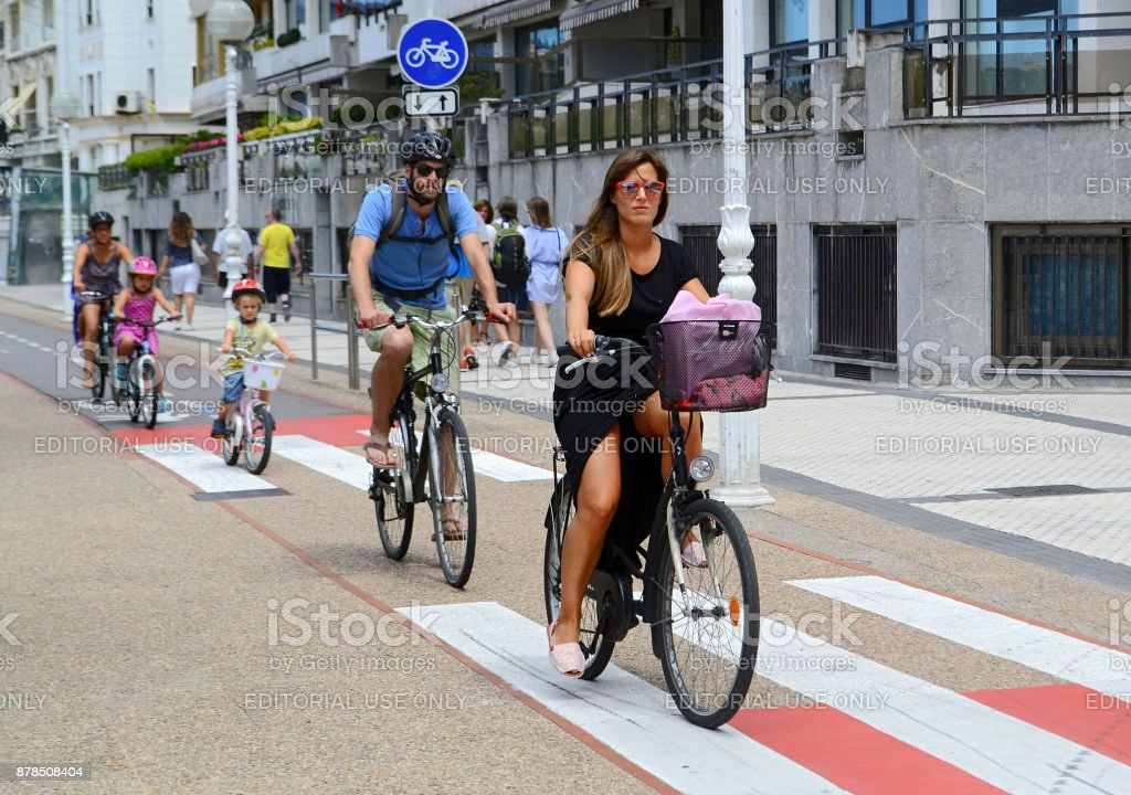 Adults and children ride bike stock photo