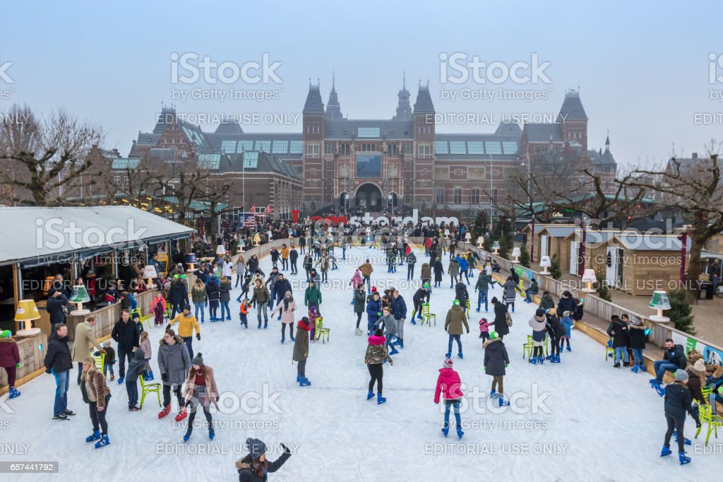 Adults and children skating. stock photo