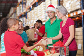 istock Adults and children volunteering at Christmas charity toy donation drive 175544917
