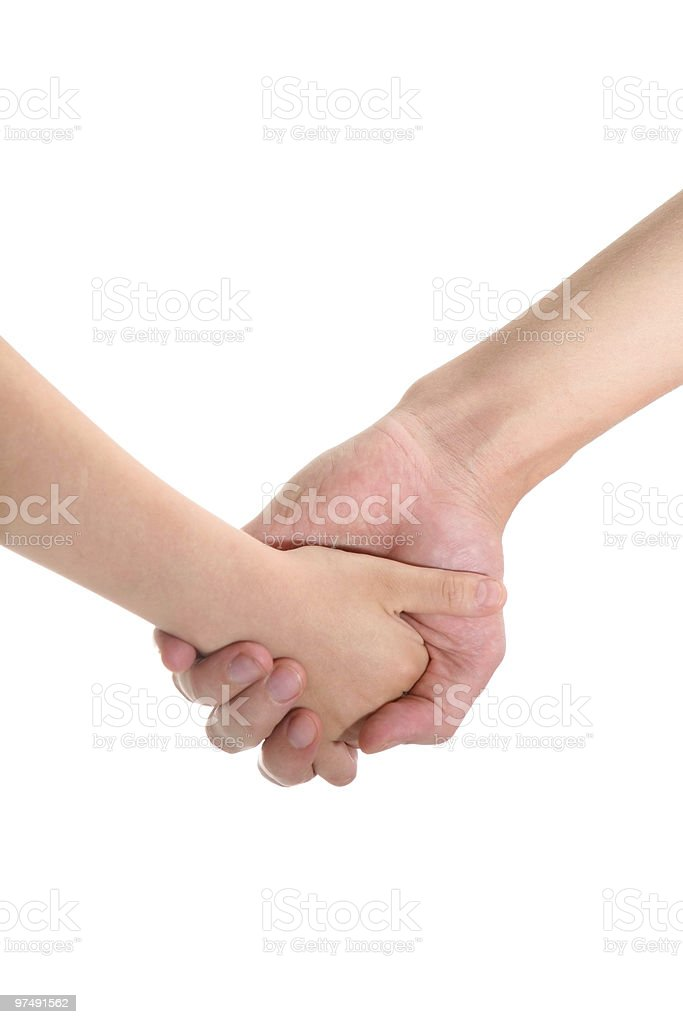adult's and child's hands holding each other royalty-free stock photo