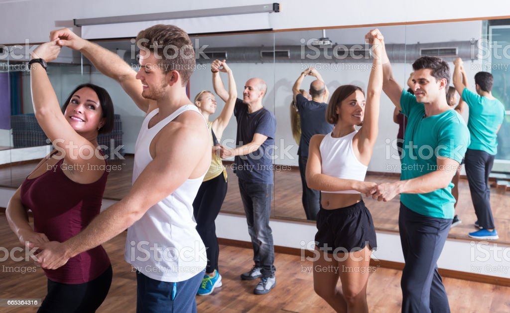 Adults dancing bachata together in dance studio stock photo