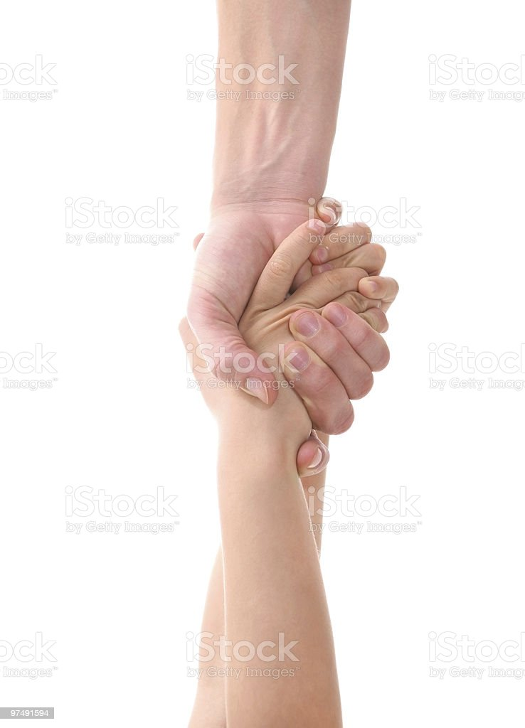 adult's hand pulling child's hands to help royalty-free stock photo
