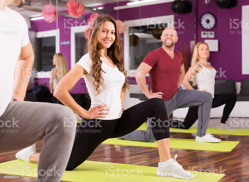 Adults having group fitness class stock photo