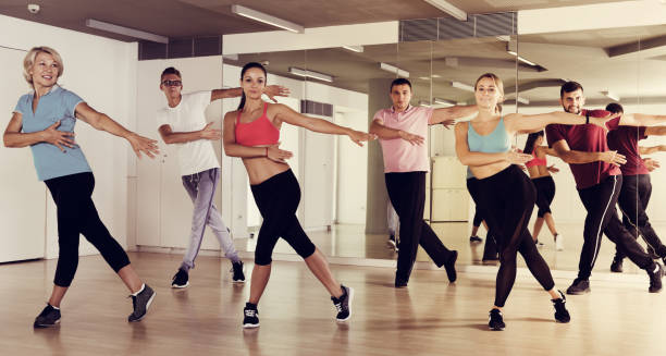 adults of different ages dancing at dance class Happy active sporty adults of different ages dancing at dance class dance studio stock pictures, royalty-free photos & images