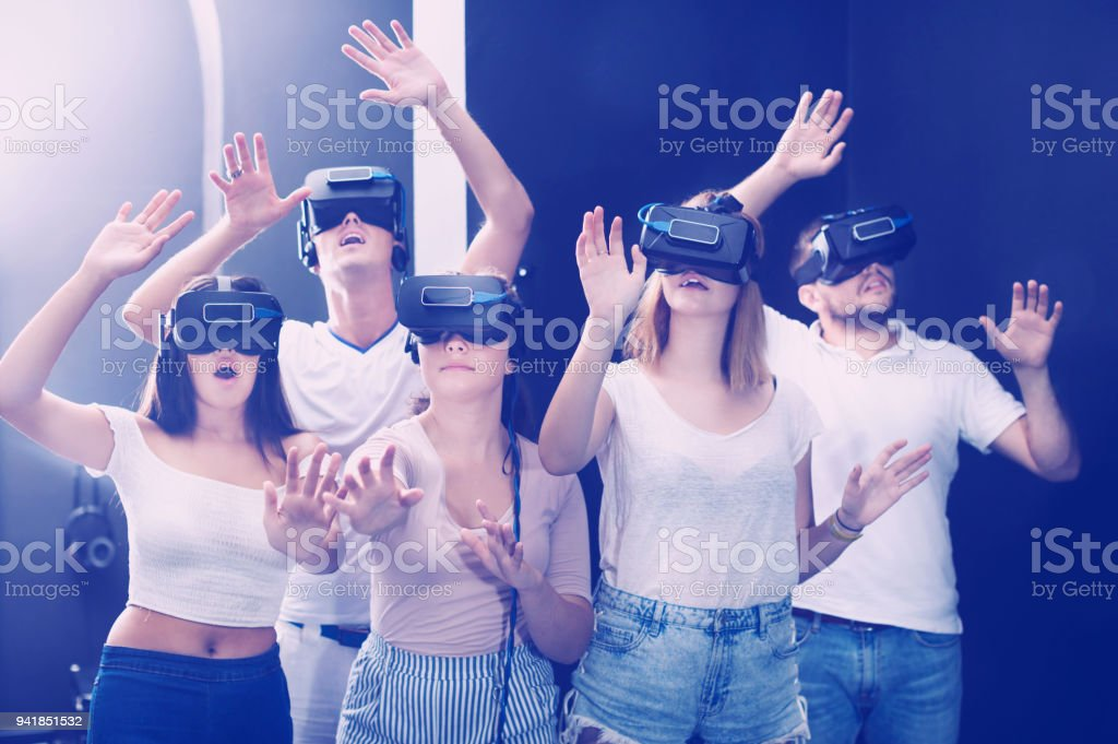 Adults posing in quest room stock photo
