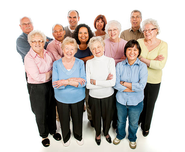 adults standing in a group - 60 69 years stock photos and pictures