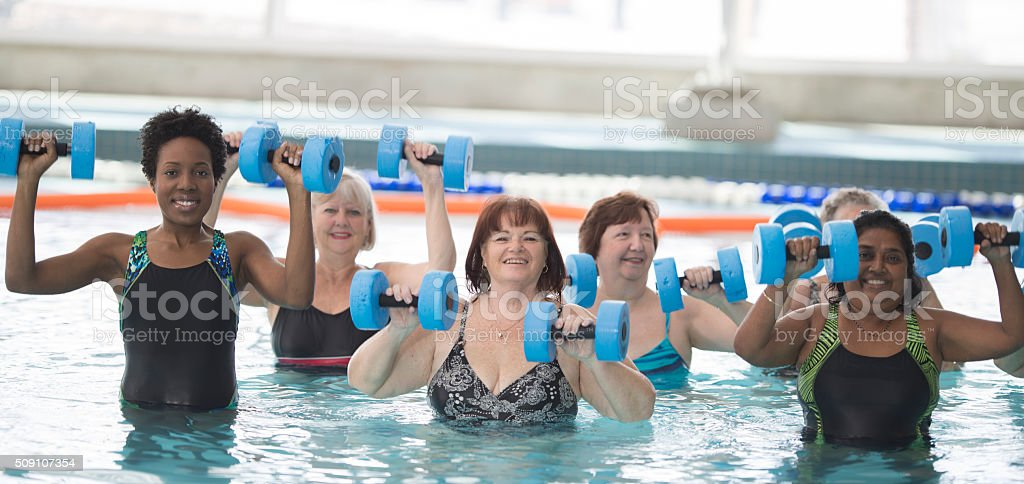 Adults Taking a Water Fitness Class stock photo