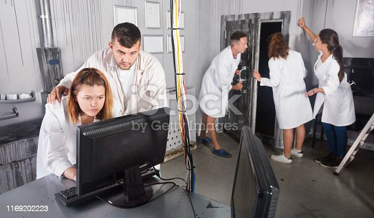 Group of adults in play trying to get out of escape room stylized under the laboratory