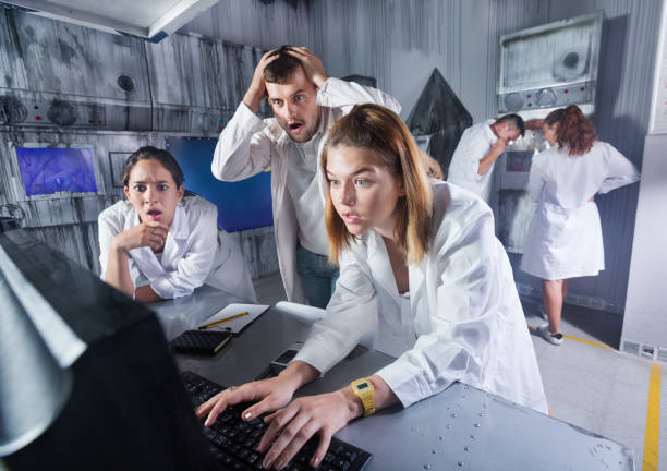 Adults trying to get out of escape room stock photo