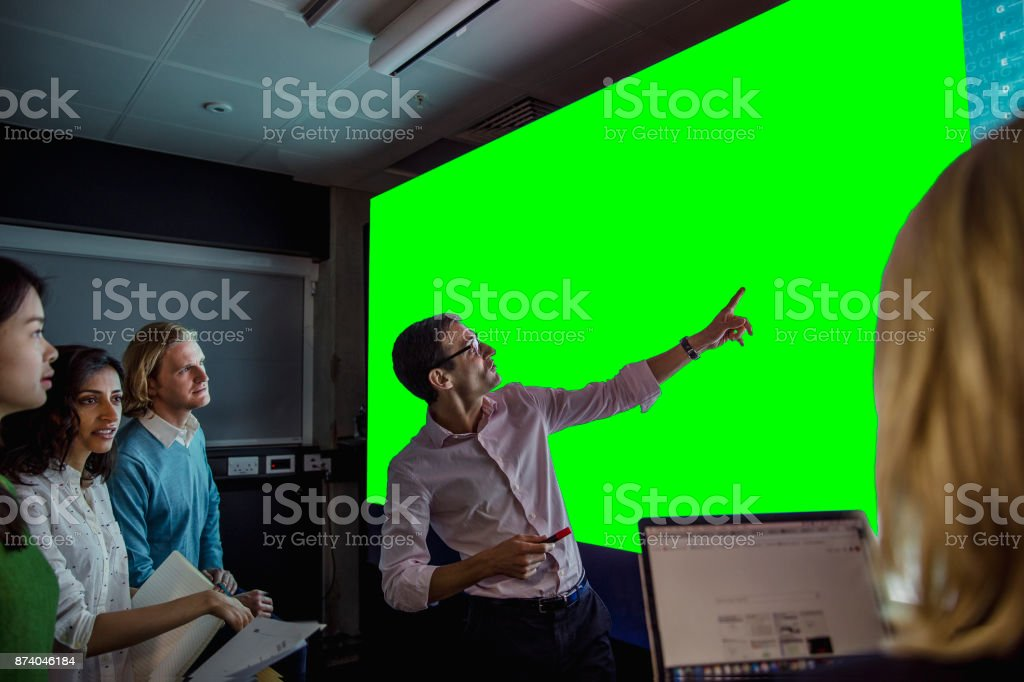 Adults Viewing a Large Display Green Screen stock photo