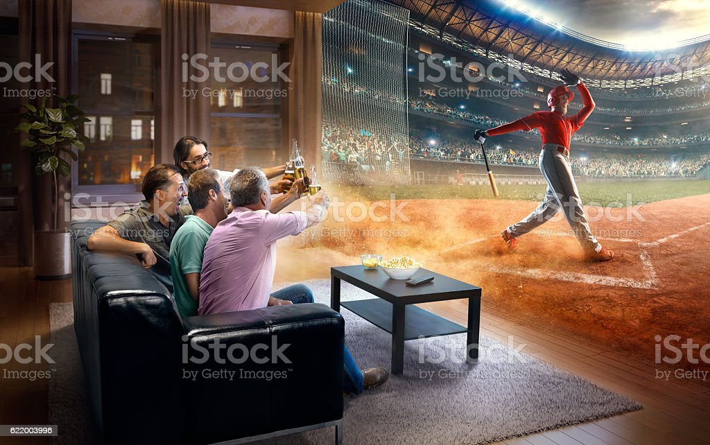 Adults watching very realistic Baseball game at home stock photo