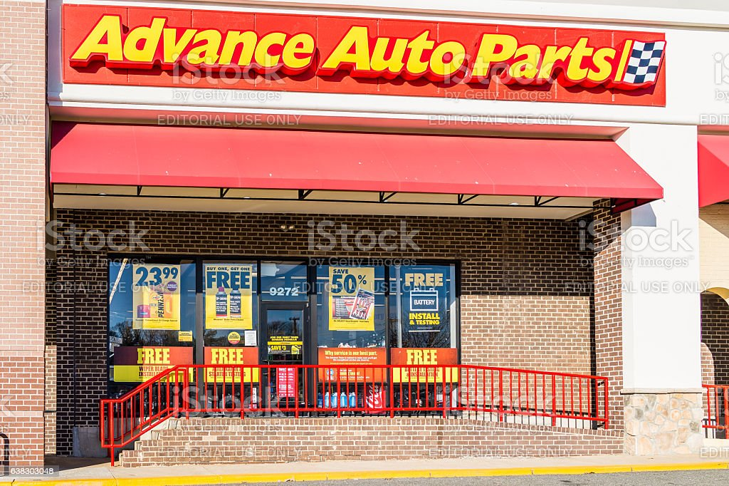 Advance auto parts store facade with customers stock photo