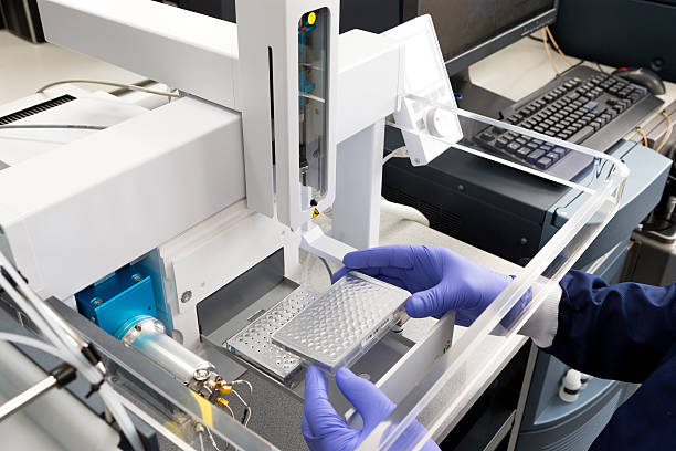Advanced Medical Technology Testing A scientific medical machine, used to sample and detect disease and substances. The Equipment is very high tech and innovative. immunology stock pictures, royalty-free photos & images