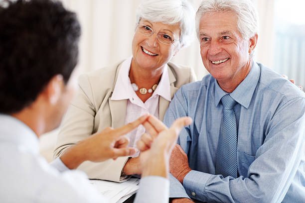 Advantages of investiment - Excited old couple listening to fina stock photo