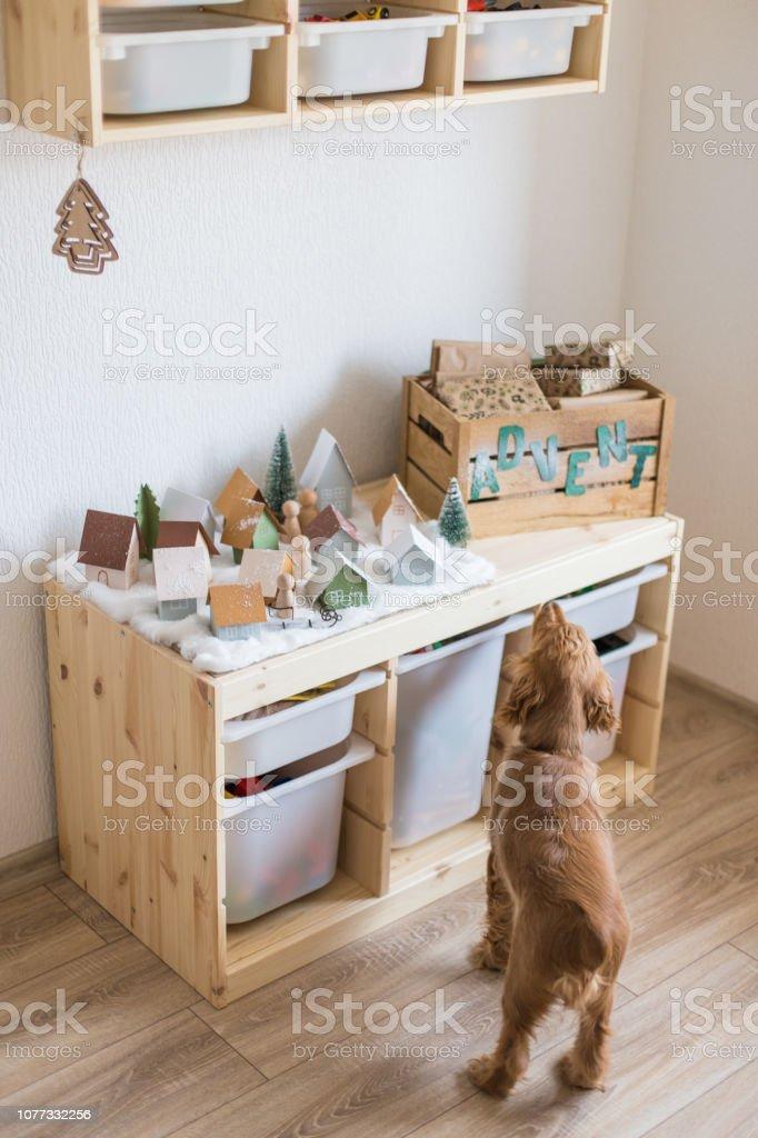 Christmas Advent Calendar in children room. Christmas miniature...