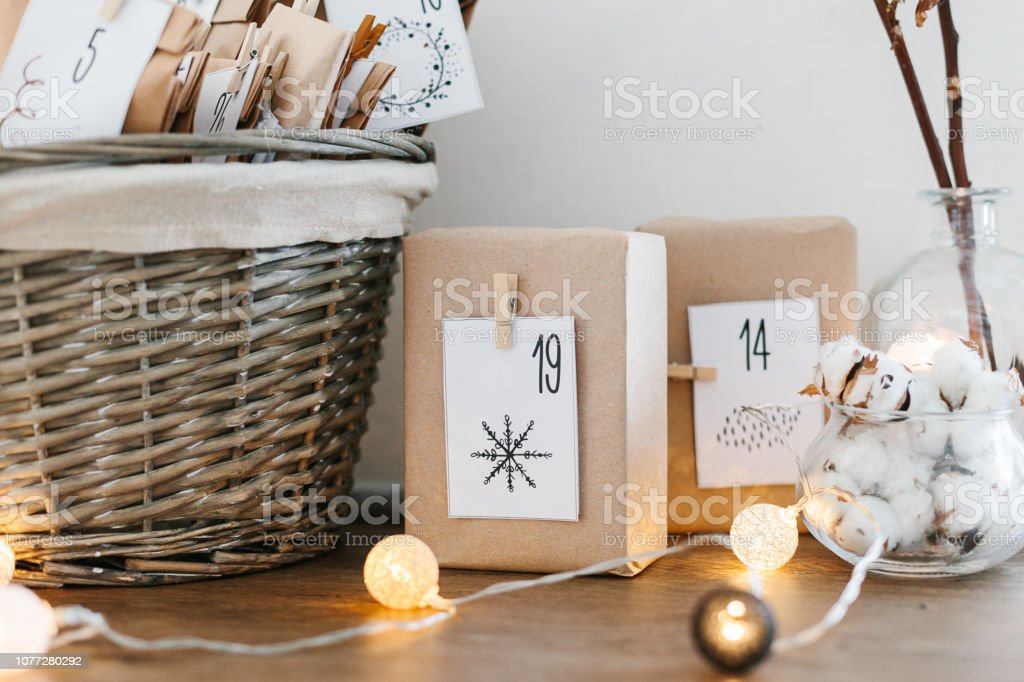 Advent calendar waiting for Christmas. Basket with envelopes with...