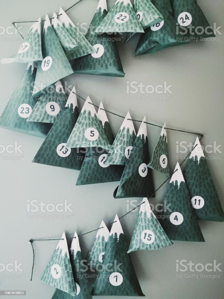 Advent calendar with Christmas gifts hanging on Wall stock photo
