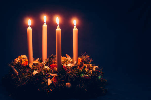 4. advent candle burning on advent wreath