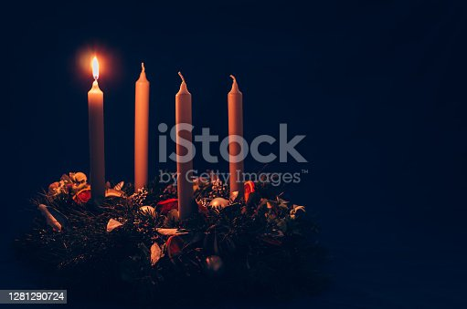 4 candle advent wreath on black background copy space