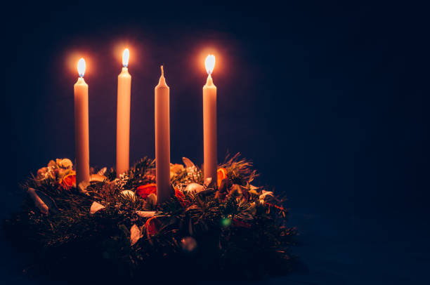 3. advent candle burning on advent wreath