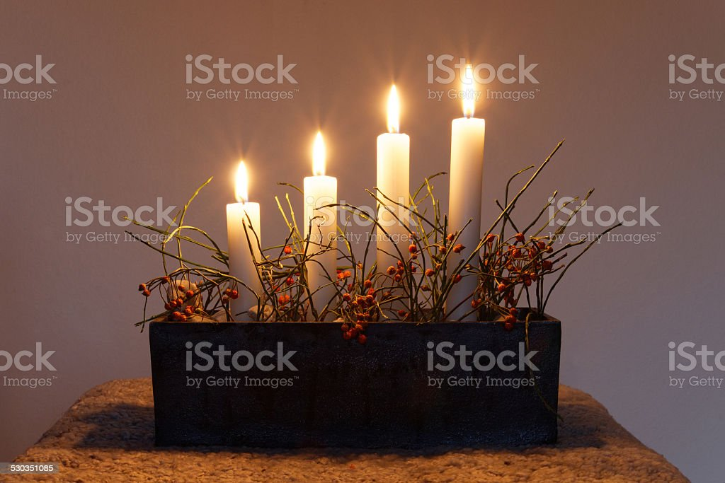 Advent Candle stick holder with four candles stock photo