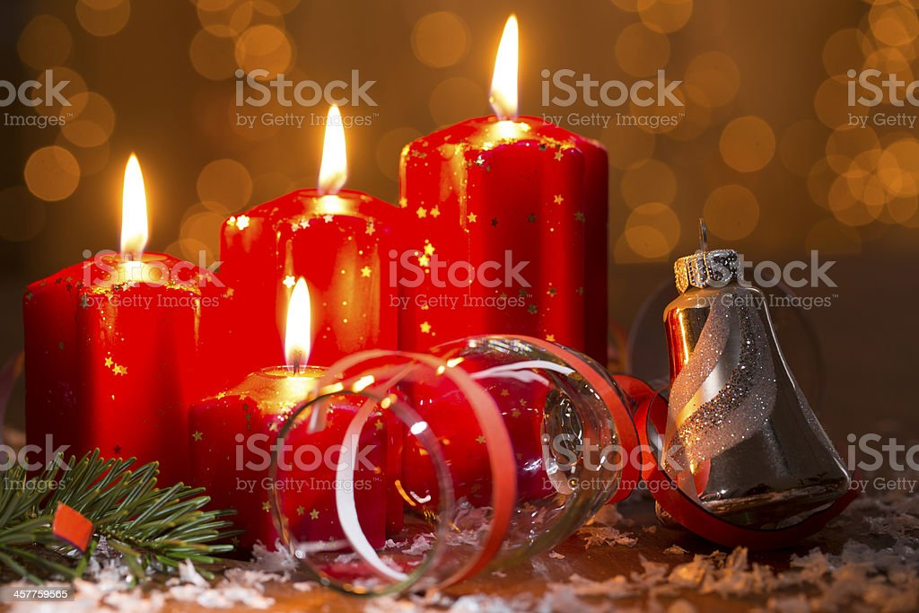 advent candles with champagne glass and bell royalty-free stock photo