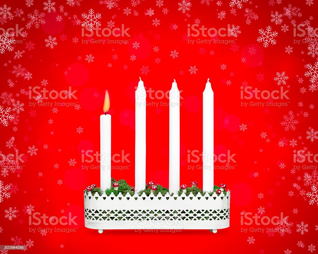 Advent candlestick with one burning candle. stock photo