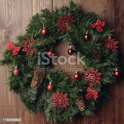 Advent Christmas wreath on wooden door decoration - image