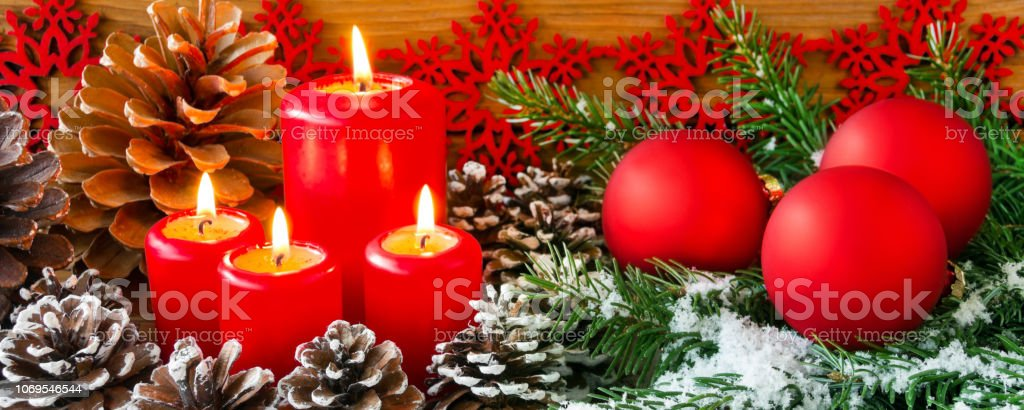Advent Decoration and four red candles close up