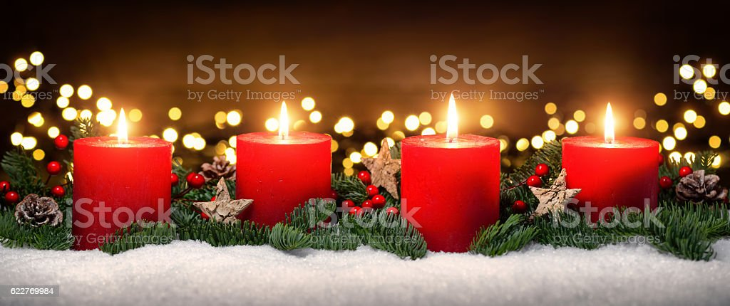 Advent decoration with four burning candles stock photo