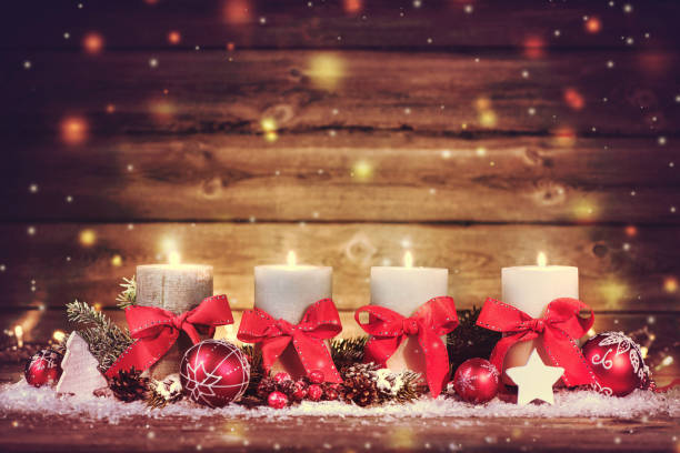 Advent decoration with four burning candles. stock photo