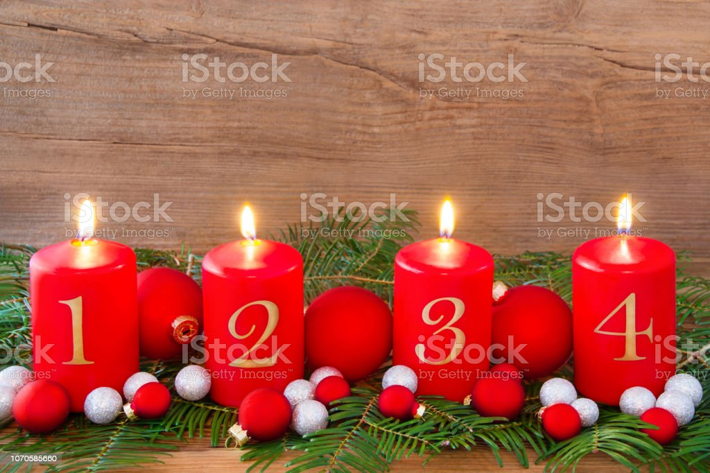 Advent decorations and four red candles close up
