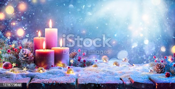 Four Purple Candles With Bokeh In Shiny Background